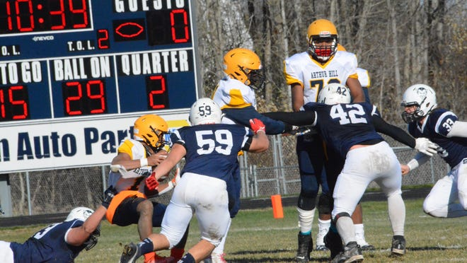 Sault High's John Burke (73), Daylan Lujan (59), Nick Albakal (42) and Vinnie Febles (33) get into the backfield and pursue Saginaw Arthur Hill quarterback Jordan Pierce (1) during a playoff game this past Saturday at VanCitters Field. Sault High is back in playoff action at Ludington at 7 p.m. Friday night.