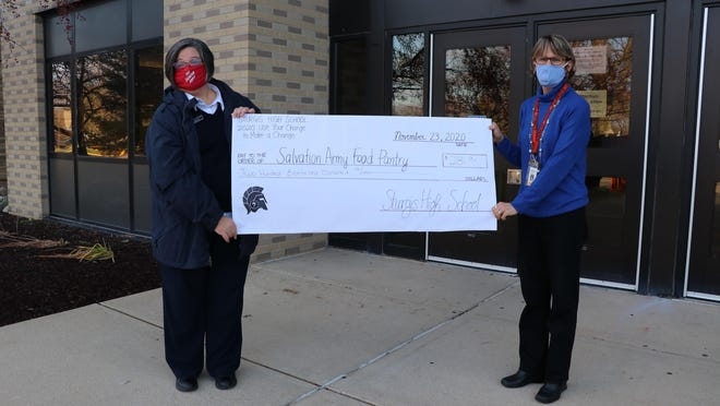 Sturgis High School education assistant Cindy Logan, right, presented a check to Salvation Army Captain Sharyn Tennyson.