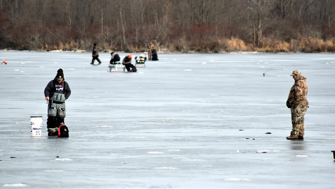 More than a dozen ice fishermen were scattered over Messenger Lake Thursday afternoon west of Coldwater.