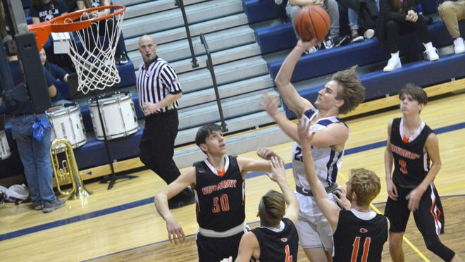 Sault High' Vinnie Febles puts up a shot in the lane during a boys basketball game against Newberry last season. Most winter sports schedules have been moved back to February starting dates.