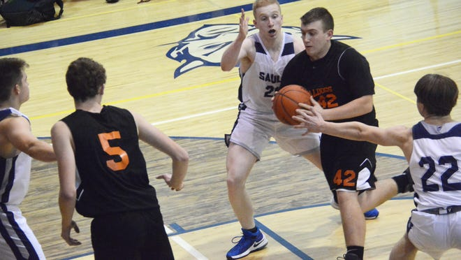 Rudyard's EJ Suggitt drives into the lane during a game at Sault High last season. Suggitt is one of four returning starters for the Bulldogs.