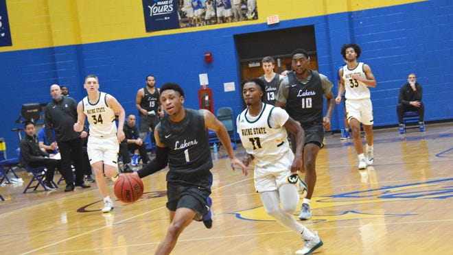 Lake Superior State's David Wren (1) leads a fast break during a home game against Wayne State in early January. The Laker men's basketball team is scheduled to play Michigan Tech at home this Friday and Saturday, at the Bud Cooper Gym.
