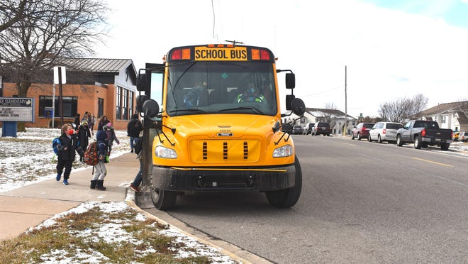 Students at Michener Elementary School get ready to load the bus and depart from school Thursday afternoon in Adrian. A wintry mix of snow, ice and freezing rain caused several school districts to use their first snow Day of the school year Tuesday. Adrian was one of a handful of county districts that did not cancel school that day because of the weather.