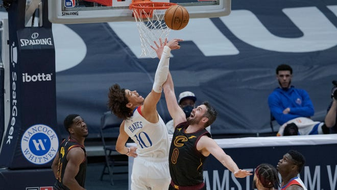 Cavaliers forward Kevin Love (0) defends against New Orleans Pelicans center Jaxson Hayes (10) during the first half of the Pelicans' 116-82 win Friday night. [Matthew Hinton/Associated Press]