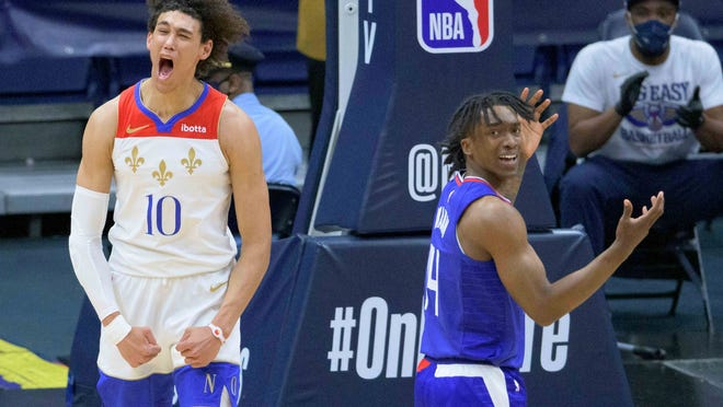New Orleans Pelicans center Jaxson Hayes (10) celebrates a score and getting fouled by Los Angeles Clippers guard Terance Mann (14) in the first half of an NBA basketball game in New Orleans, Sunday, March 14, 2021. (AP Photo/Matthew Hinton)