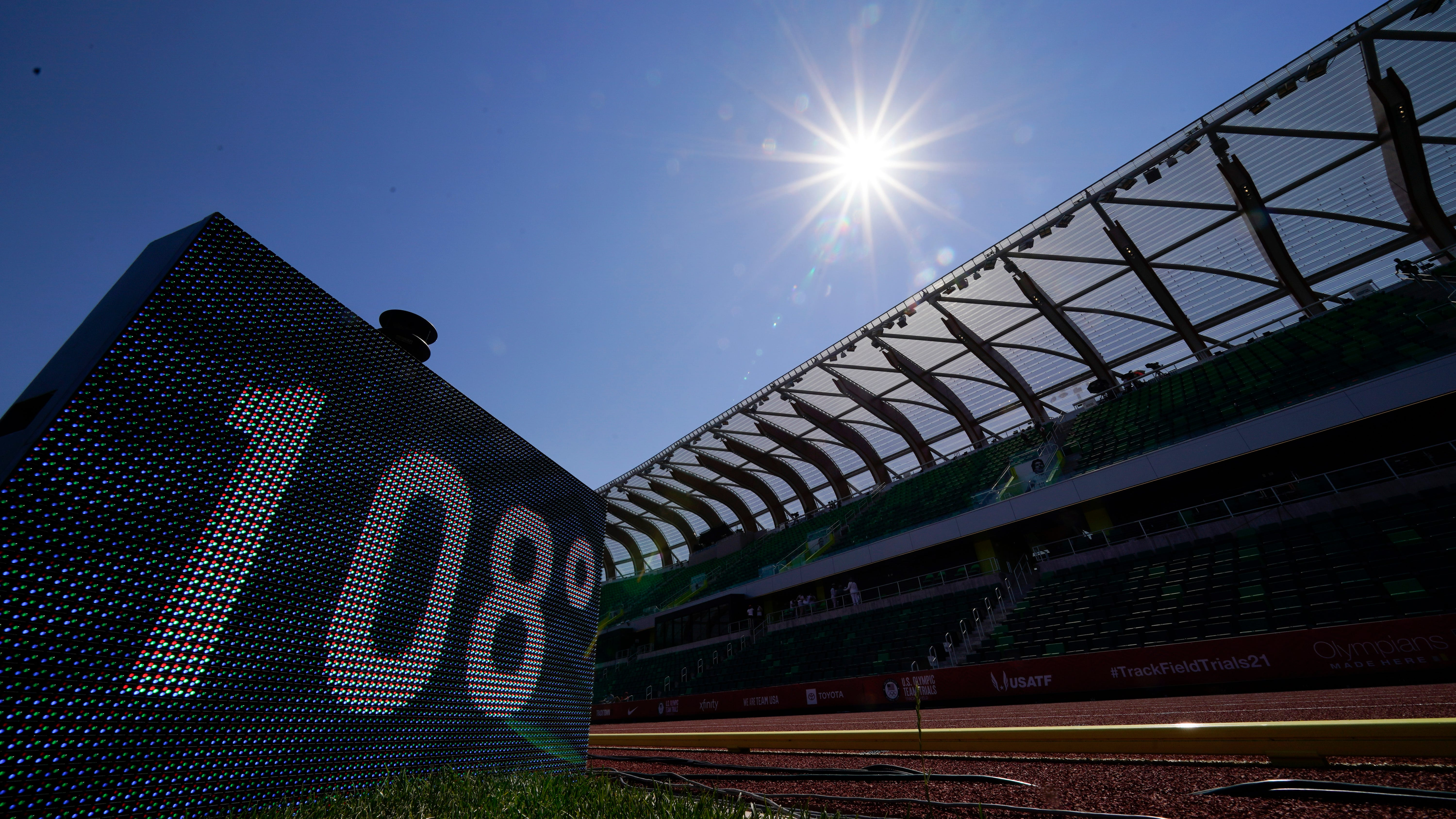 A sign displaying the current temperature is shown after events were postponed due to high heat at the U.S. Olympic Track and Field Trials Sunday, June 27, 2021, in Eugene, Ore. (AP Photo/Charlie Riedel)