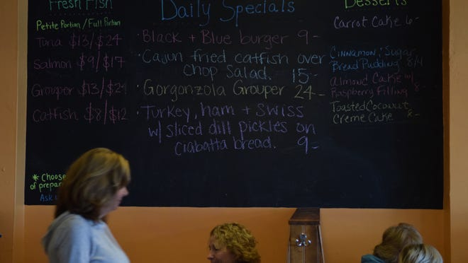 A board shows the fresh fish of the day at Blue Water Grill.