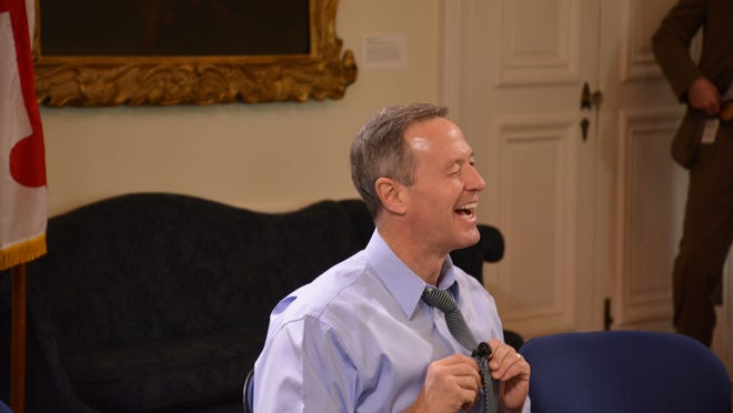 Gov. Martin O'Malley laughs as he prepares to address the media in the Governor's Reception Room at the Maryland State House in Annapolis on Friday.