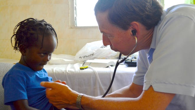 Dr. Robert Gunther, a pediatrician from Waynesboro, examines a 4-year-old girl during a medical clinic at Jean Wilfred Albert Medical Clinic in Cherident, Haiti, on Monday, June 9, 2014. Gunther was among several who traveled with a Tinkling Spring Presbyterian Church mission trip to Haiti. Cherident, in the southern mountains of the Caribbean nation, has been a partner with members of the church for more than 20 years.
