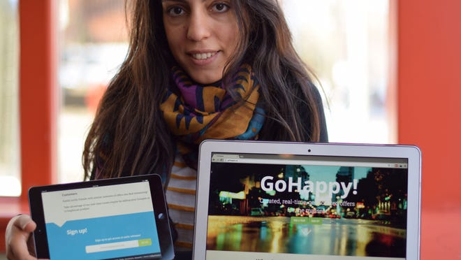 University of Delaware graduate student Elpiniki Apostolaki-Iosifidou shows off the website and mobile app of her startup GoHappy, one of six finalists in the 2015 Hen Hatch competition.