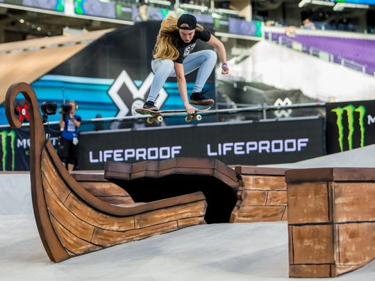 Meagan Guy catches air during the X Games Minneapolis women's skateboard street final on July 14.