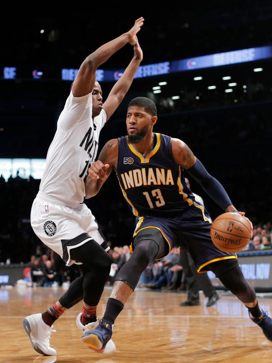 Indiana Pacers' Paul George (13) dribbles against Brooklyn Nets' Isaiah Whitehead (15) during the first half of an NBA basketball game, Friday, Feb. 3, 2017, in New York. (AP Photo/Andres Kudacki)