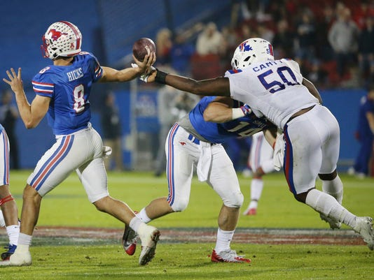 Louisiana Tech defensive end Deldrick Canty (50) gets a hand on an attempted pass from SMU quarterback Ben Hicks (8) during the second quarter of the Frisco Bowl NCAA college football game Wednesday, Dec. 20, 2017, in Frisco, Texas. (Andy Jacobsohn/The Dallas Morning News via AP)