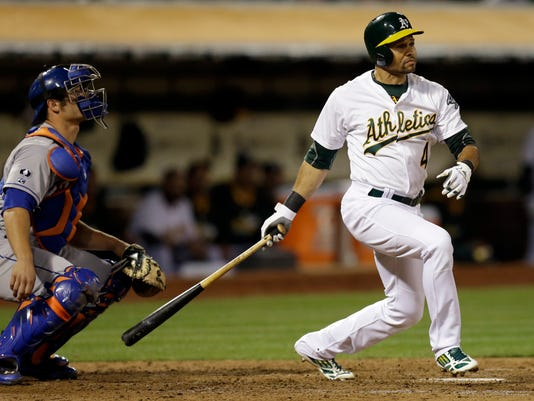 Oakland Athletics' Coco Crisp watches his three-run triple off New York Mets' Dillon Gee in the fourth inning of a baseball game Tuesday, Aug. 19, 2014, in Oakland, Calif. (AP Photo/Ben Margot)