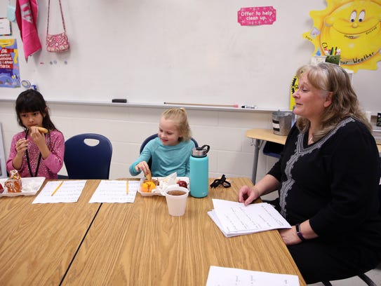 Teacher Robin Johnson talks with second-grade gifted