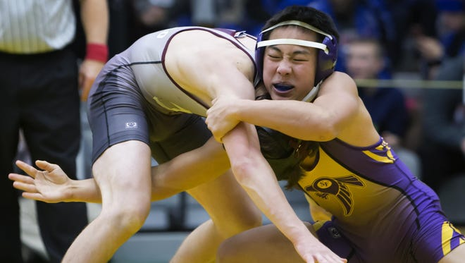 Sheboygan Falls's Anthony Xiong (facing) and Antigo's Benjamin Stimac wrestle in the 11th-place match at the On The Water Classic on Wednesday.