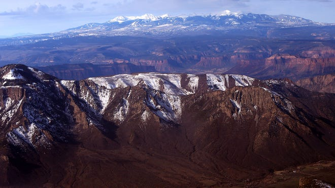 The backcountry southwest of Grand Junction in a view west toward the La Sal Mountains in Utah is shown during an April 3 flight. In remote areas such as this, the Bureau of Land Management has identified wildlife emphasis zones as part of its continuing revision of the resource management plan for its Grand Junction Field Office.