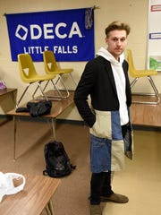 Jacob Waldock of Little Falls shows one of his clothing