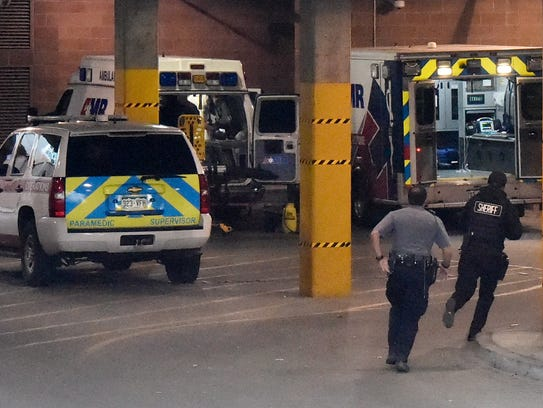 El Paso County Sheriff Deputies run into the ambulance entrance at UCHealth Memorial Hospital Central following a shooting in Colorado Springs, Colo., Monday, Feb. 5, 2018. (Jerilee Bennett/The Gazette via AP)