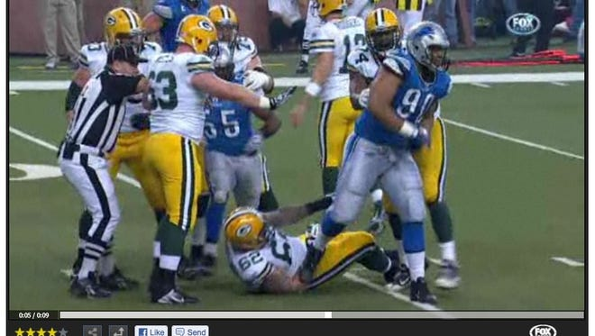 Video frame grab of the television program by FOX sports of Ndamukong Suh as he stomps on #62 for the Green Bay Packers in the third quarter of the game between the Detroit Lions and the Green Bay Packers at Ford Field on Thanksgiving, Nov. 24, 2011.