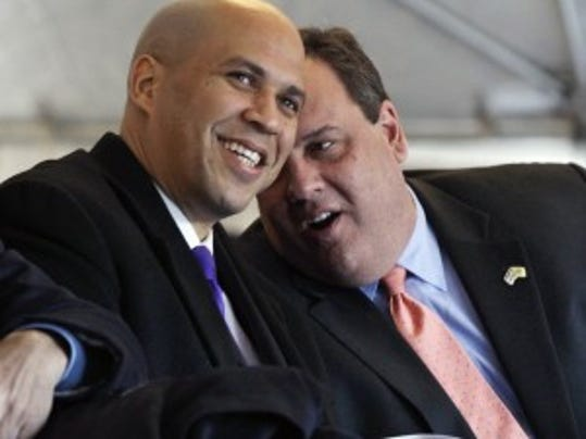 U.S. Sen. Cory Booker and New Jersey Gov. Chris Christie in  2012 - long before the ice bucket challenge. (Associated Press photo).
