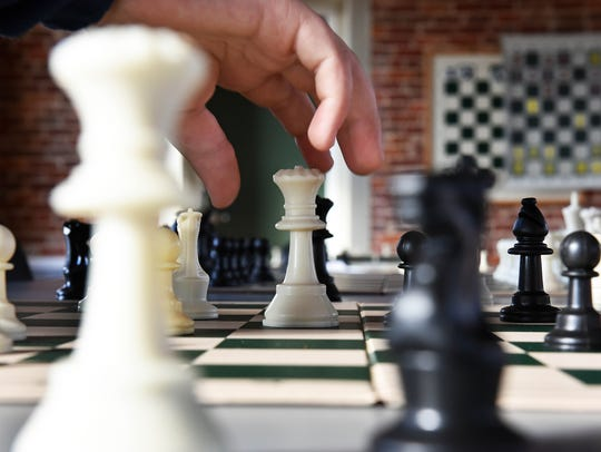 Students practice chess after school at the Franklin