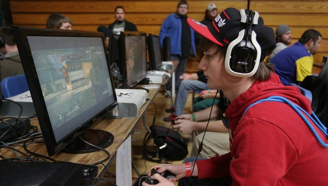 "Derek Deitrich of Reedsburg plays ""Call of Duty"" at the Evercon gaming convention at D.C. Everest Junior High School in Weston in 2013."