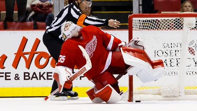 Detroit Red Wings goalie Jimmy Howard (35) reacts after Columbus Blue Jackets center Boone Jenner (not pictured) scores a shootout goal in overtime at Joe Louis Arena. Columbus won 1-0 in an overtime shootout.