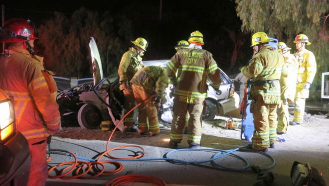 Crews with the Fillmore and Ventura County fire departments rescued the driver of a vehicle that crashed into a wall Friday night on Highway 23.