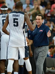 USA head coach Mike Krzyzewski celebrates with guard Kevin Durant (5) after winning the gold in the men's basketball final against Spain in the London 2012 Olympic Games at North Greenwich Arena in London on Aug. 11, 2012.
