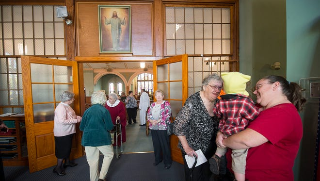 The congregation greets each other after Sunday worship at Trinity (Roth's) United Church of Christ in Jackson Township. Trinity is celebrated 250 years in 2015.
