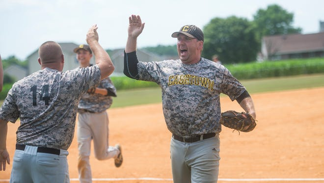 Cashtown's Eric Ketterman celebrates with teammates after a triple-play during the South Penn playoff game against Brushtown on July 31, 2016.