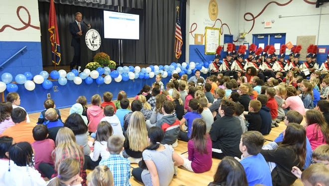 Gov. Bill Haslam greets students on Thursday to celebrate the state's gains in science test scores at Mount Olive Elementary on Oct. 27, 2016. Tennessee's fourth- and eighth-graders outperformed students nationally in the 2015 National Report Card, according to science test scores released late Wednesday.