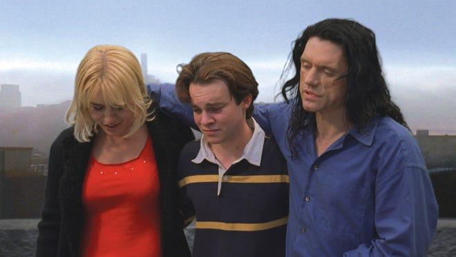 "Juliette Danielle, left, Philip Haldiman and Tommy Wiseau in ""The Room."""