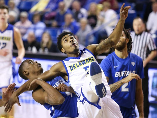 Delaware's Anthony Mosley watches his lay-in go through the hoop as he falls into Buffalo's Davonta Jordan in the first half at the Bob Carpenter Center Wednesday.