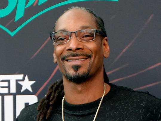 FILE - In this Sept. 17, 2016, file photo, Snoop Dog smiles at the BET Hip Hop Awards in Atlanta. The National Hockey League is hoping Snoop Dogg can heat up interest on the ice as the Stanley Cup playoffs get underway. The rapper and hockey fan is appearing in a series of Hockey 101 videos in which he gives shoutouts to the teams and some of the players. (AP Photo/Tami Chappell, File)