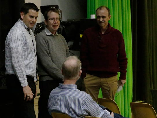 """Ben Arbaugh, a business professor at the University of Wisconsin-Oshkosh, greets colleagues and friends Thursday at his """"Last Lecture."""""""