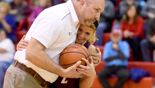 James Carter hugs Danielle Brenneman after scoring her 1,000 career point in 2017. Carter, who stepped down as Stuarts Draft's girls basketball coach in 2018, will return to that position. He was named coach Wednesday, taking over for Brad DeWitt.