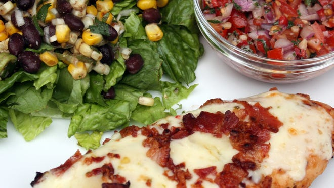 Clockwise from top left, Charred Corn and Black Bean Salad, Pico de Gallo and Monterrey Chicken.