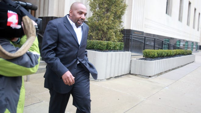 Ex-Pontiac Schools Assistant Superintendent Jumanne Sledge leaves the Federal Courthouse after being arraigned March 12, 2012