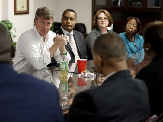 Missouri Democratic gubernatorial candidate Chris Koster, left, meets with health care professionals during a tour of Myrtle Hillard Davis Health Center.