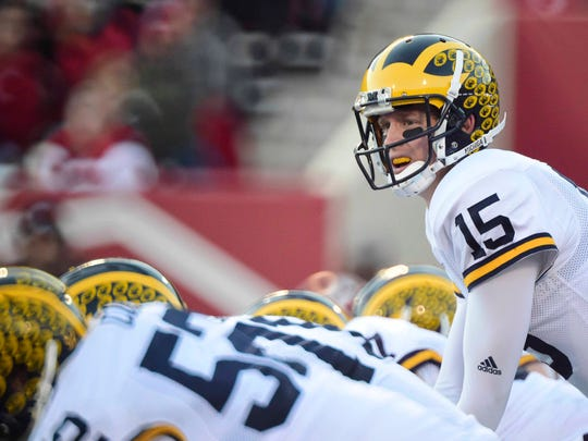 Nov 14, 2015; Bloomington, IN, USA; Michigan Wolverines quarterback Jake Rudock (15) prepares to call to snap the ball during the second quarter of the game against the Indiana Hoosiers at Memorial Stadium.