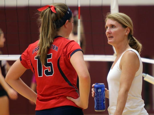 Eastchester volleyball setter Karly DiSanto talks with head coach Kathy DePippo during a match at Harrison High School on Sept. 22, 2016.