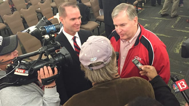 Republican mayoral candidate Chuck Brewer (left in background) and Indianapolis Mayor Greg Ballard take questions from the media on Saturday, Jan. 31, 2015, after the Marion County Republican Slating Convention.