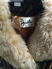 The distinctive Fandel's label is shown in a coat in