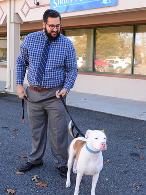 Mike Hindi and Dallas stand outside of their new Sirius Pet Spa that is opening soon in Ocean Pines.  Friday, Nov. 17, 2017.