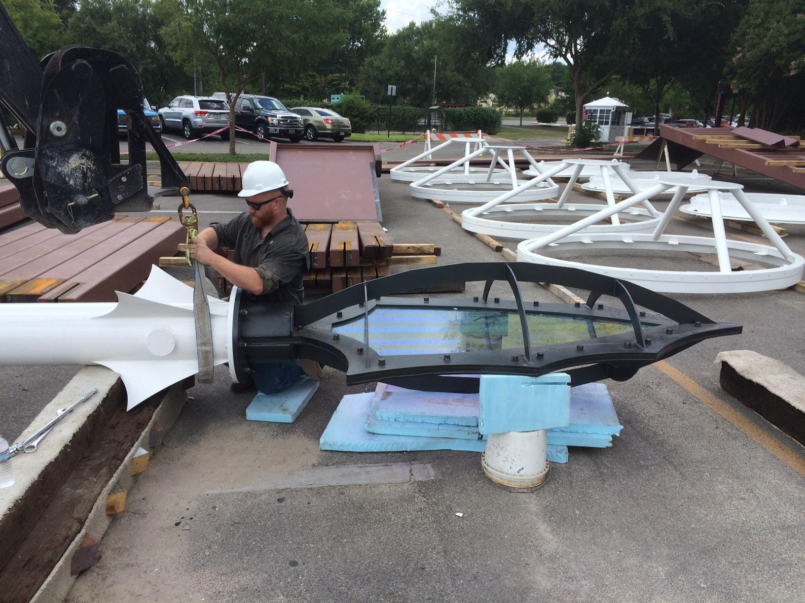 Chris Horne of Master Craftsman Studio installing the MCS spear to canopy structure. (Photo Master Craftsman Studio photo) & Champions Club reflects iconic elements of FSU Seminole Tribe