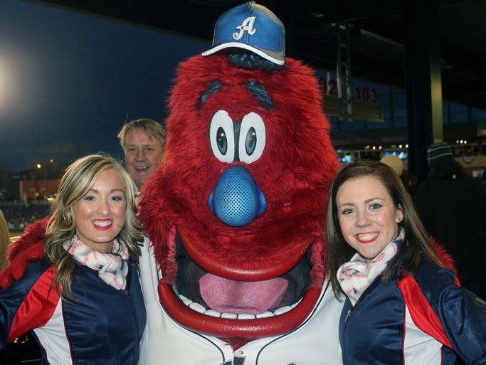 Wild Aces girls Amanda Strong (left) and Marlin Herzig with team mascot Archie inside Aces Ballpark during opening day of Minor League Baseball on Thursday, April 3, 2014.