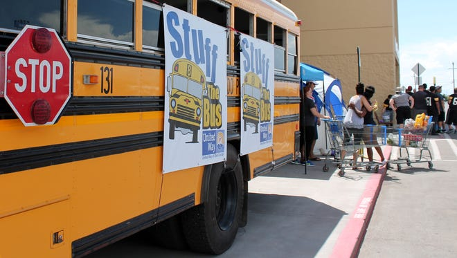 """Locals participated in the """"Stuff the Bus"""" event Saturday afternoon at the Walmart Supercenter."""