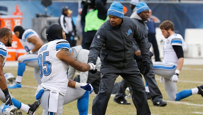Detroit Lions head coach Jim Caldwell shakes hands with tight end Eric Ebron (85) before an NFL football game against the Chicago Bears Sunday, Dec. 21, 2014, in Chicago.